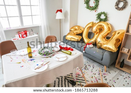 Interior of messy room after New Year party Royalty-Free Stock Photo #1865713288
