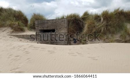 WW II Bunker Abandoned on the beach #1866064411