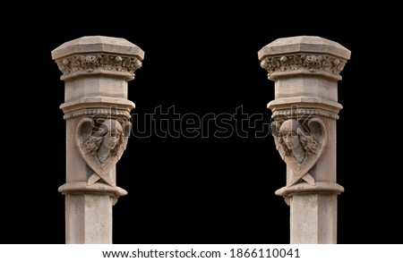 Elements of architectural decorations of buildings, columns and tops, gypsum stucco molding, wall texture and patterns. On the streets in Barcelona, public places. Royalty-Free Stock Photo #1866110041