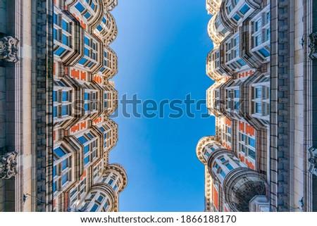 Upward view of old regency style buildings on Sicilian Avenue in Bloomsbury, London, UK Royalty-Free Stock Photo #1866188170