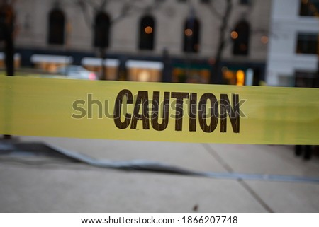 Caution tape warns you to use caution Royalty-Free Stock Photo #1866207748