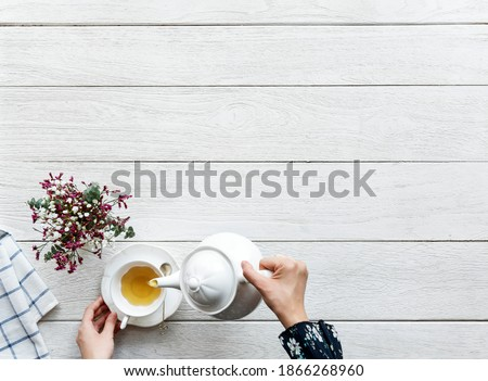 Aerial view of hot tea drink break and relaxation concept with copy space