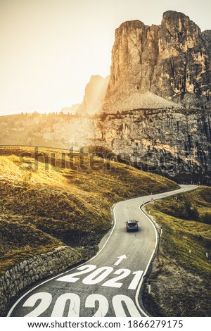 2021 New Year road trip travel and future vision concept . Nature landscape with highway road leading forward to happy new year celebration in the beginning of 2021 for fresh and successful start . #1866279175