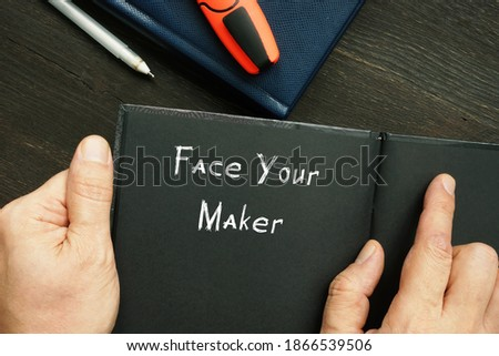 Lifestyle concept about Face Your Maker with sign on the sheet.