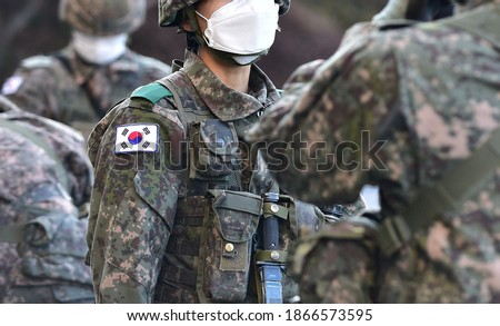 Korean Army Soldier wearing a Mask for Coronavirus. Royalty-Free Stock Photo #1866573595