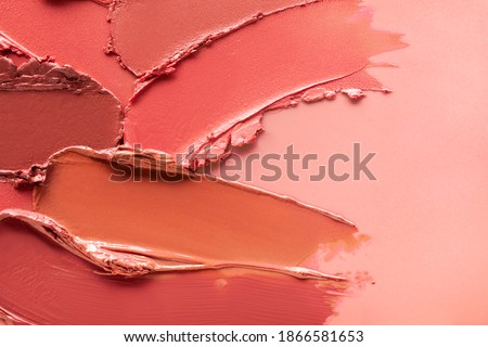 Red orange brown lipstick background texture smudged Royalty-Free Stock Photo #1866581653