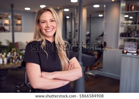 Portrait Of Female Stylist Or Business Owner In Hairdressing Salon Royalty-Free Stock Photo #1866584908