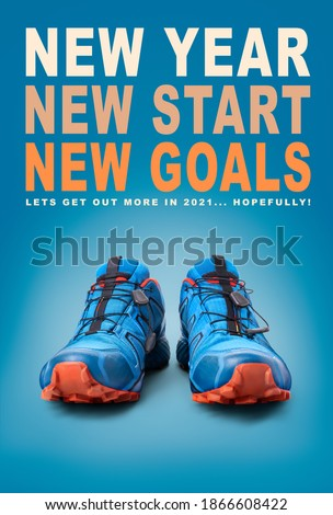 New year, new start business and health resolution concept for 2021. Front view of blue trainers on a blue background.
