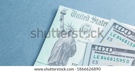 A US stimulus check with some one-hundred-dollar bills Royalty-Free Stock Photo #1866626890