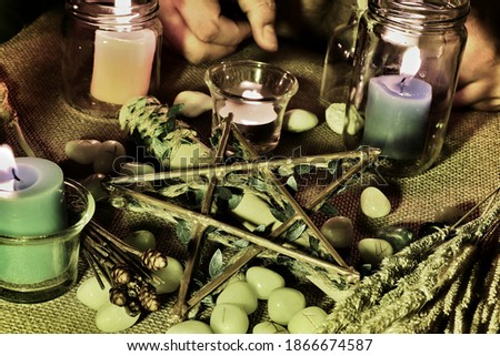 A spell of protection using the pentacle and ancient chants. This picture is used to compose an article on ancient witchcraft.