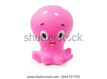 Childrens rubber toy octopus isolated on white background side view