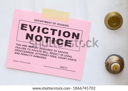 Pink Eviction Notice Taped on Front Door. Royalty-Free Stock Photo #1866745702