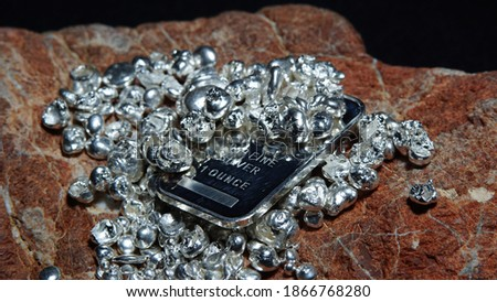 Silver bar pure silver and 999 silver shots and nuggets                               Royalty-Free Stock Photo #1866768280