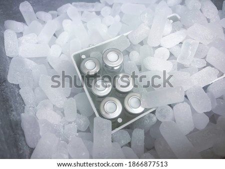 Closeup on vials with crimp caps placed on dry ice prepared for medical transport. Selected focus. Royalty-Free Stock Photo #1866877513
