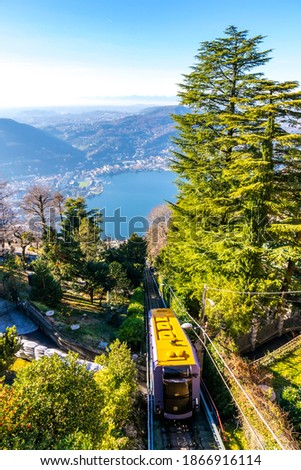 Como-Brunate funicular is a funicular railway that connects the city of Como with the village of Brunate in Lombardy, Italy. Operated since 1894. Como Lake on background Royalty-Free Stock Photo #1866916114