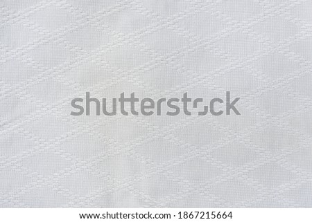 White material of a suit for practicing martial arts Judo and Aikido. Background image. Royalty-Free Stock Photo #1867215664