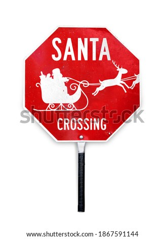 Santa crossing sign with sleigh and reindeer. Hand-held Christmas themed stop sign used for traffic control by crossing guards. Red and white metal texture sign in octagon shape and a pole to hold.