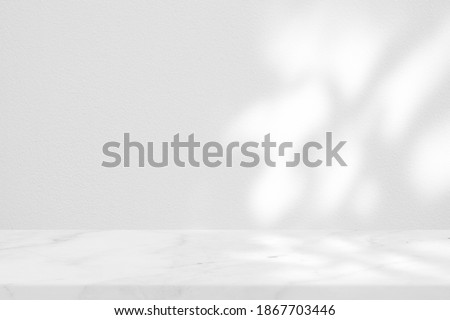 White Marble Table with Tree Shadow on Concrete Wall Texture Background, Suitable for Product Presentation Backdrop, Display, and Mock up. Royalty-Free Stock Photo #1867703446