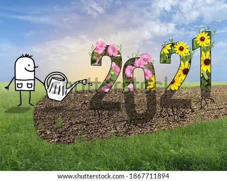 Hand drawn Cartoon Gardener Watering a big 2021 sign, in a Green field photo