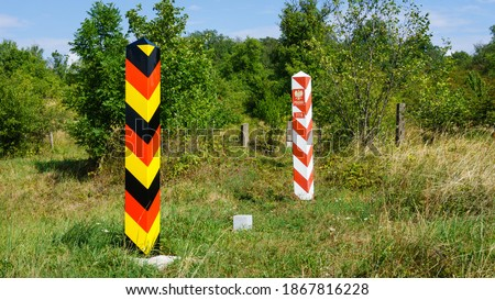 Unguarded German-Polish border crossing close to Szczecin, border pillars on the line between the two countries Royalty-Free Stock Photo #1867816228