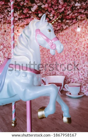 Children's carousel horse on a pink background