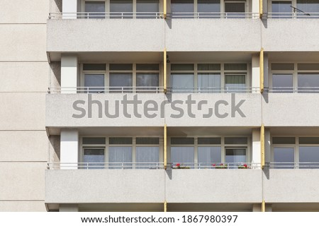 A closeup of the balconies and windows of the Monotones Residential, Delmenhorst, Germany Royalty-Free Stock Photo #1867980397