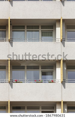 A vertical shot of the balconies and windows of the Monotones Residential, Delmenhorst, Germany Royalty-Free Stock Photo #1867980631