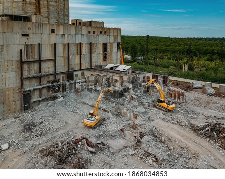 Aerial view of demolition site. Process of demolition of old industrial building #1868034853