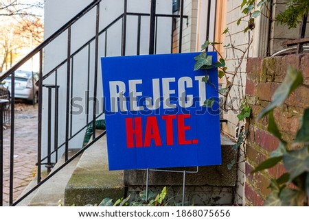 A blue yard sign that says Reject Hate is placed on the front yard of an old building ahead of US elections to ease political tension and social unrest which has peaked in the recent months.