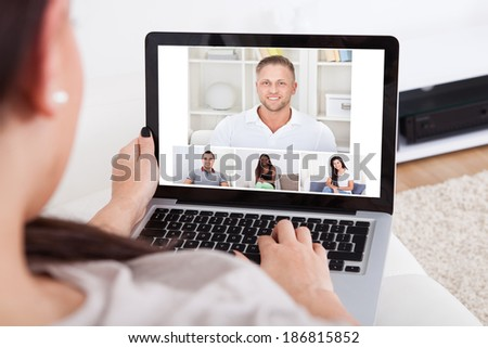 Cropped image of young woman using laptop for video conference at home #186815852