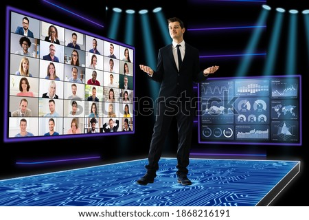 Speaker At Virtual Training Seminar. Training Conference With Audience Royalty-Free Stock Photo #1868216191