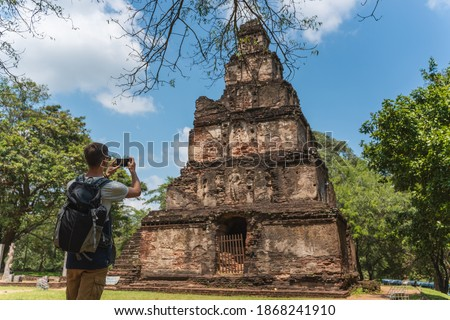 tourist take a pictur of famous  Temple in Ancient town of Polonnaruwa