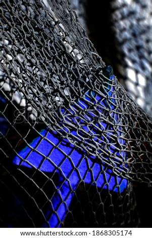 a black fishing net in a fishing boat