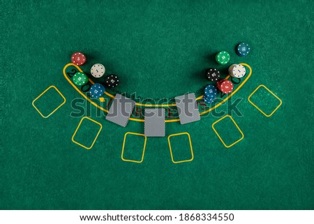 Chips cards lie on a green blackjack table top view. Casino concept, gambling Royalty-Free Stock Photo #1868334550