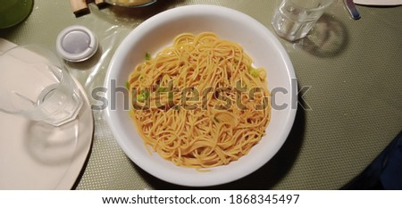 Asian Spaghetti served on a ceramic container