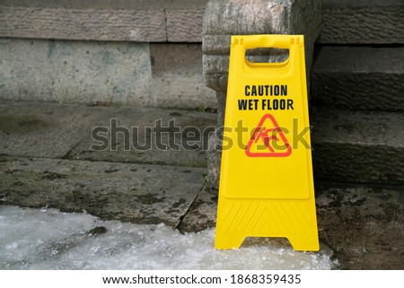 close up warning caution sign for wet slip floor