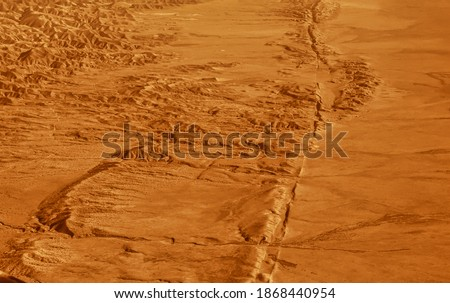 Hanford, United States - October 13 2013 : The san Andreas vault line reason for so many earth quakes is good visibly in the dried out plains desert #1868440954
