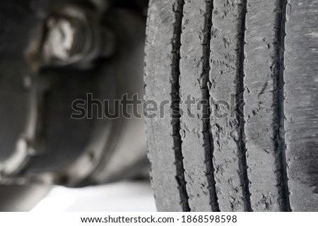 Exhausted truck tread old damaged and worn black tire tread. Change time. Tire tread problems and solutions concept  Royalty-Free Stock Photo #1868598598
