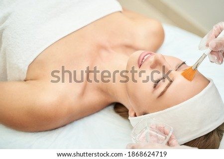 Cosmetology beauty procedure. Young woman skin care. Beautiful female person. Rejuvenation treatment. Facial chemical peel therapy. Clinical healthcare. Doctor hand. Dermatology cleanser. Royalty-Free Stock Photo #1868624719