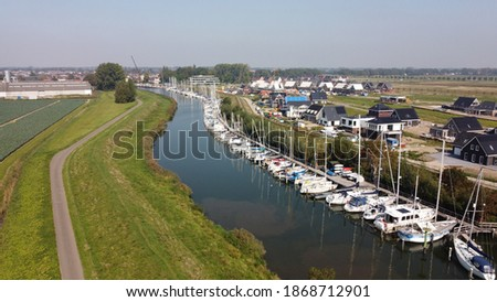Numansdorp harbor seen from the air. Located on the hollandsdiep in South Holland. Royalty-Free Stock Photo #1868712901