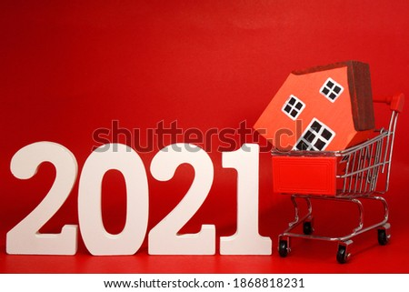 Mockup Shopping Home Property 2021 , 2021 number wood with House model on Shopping cart - Red background - home new year - Red concept of Real Estate, Property for Sale and Buy #1868818231