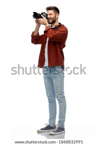 photography, profession and people and concept - happy smiling man or photographer with digital camera over white background