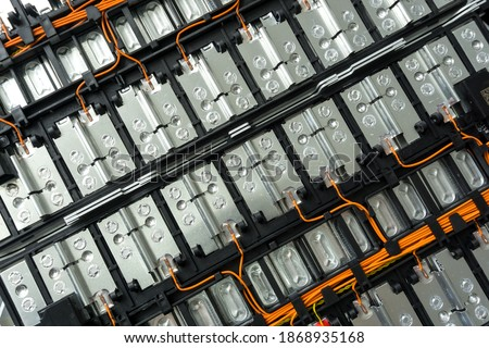 Selective focus of Electric car lithium battery pack and wiring connections internal between cells on background. Royalty-Free Stock Photo #1868935168