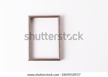 Minimalistic style. Picture frame on trendy color of 2021 Set Sail Champagne background , flat lay.