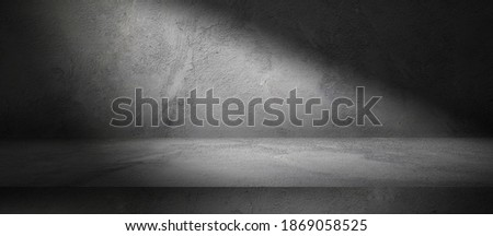 Three dimensional dark room with concrete wall and cement floor, product display background with spot light, stone texture backdrop Royalty-Free Stock Photo #1869058525