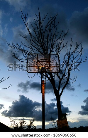 The abandoned basketball hoop during the winter season