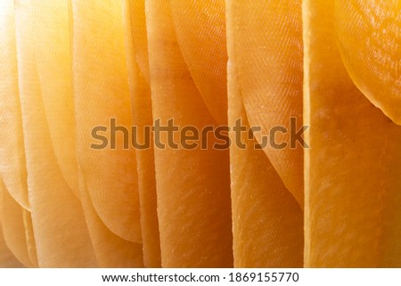 Process of rubber sheets production by drying and fumigation. High quality fumigate rubber sheets. Good yellow color. Most of all we exported to factories and abroad. Royalty-Free Stock Photo #1869155770