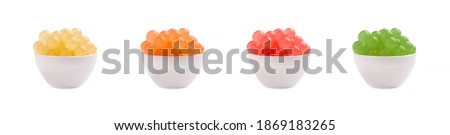 Mix tapioca pearls for bubble tea isolated on white background. Tapioca pearls in bowl. Royalty-Free Stock Photo #1869183265