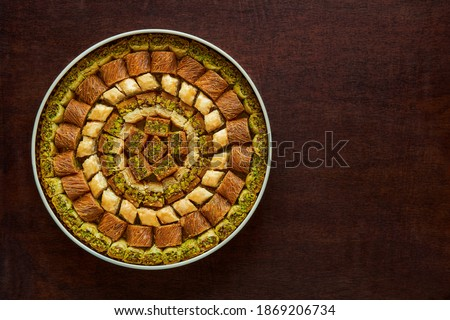 Traditional turkish, arabic sweets baklava assortment with pistachio. Top view, copy space                                    Royalty-Free Stock Photo #1869206734