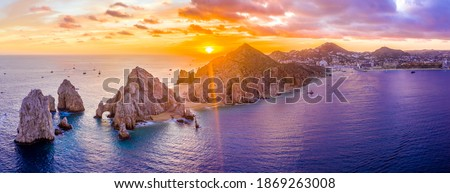 Aerial panoramic view of the Cabo San Lucas, Mexico marina and the rock formations at Lands End. the southernmost tip of the Baja California peninsula, where the Sea of Cortez meets the Pacific Ocean Royalty-Free Stock Photo #1869263008